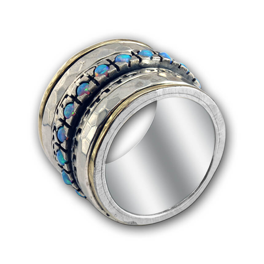 silver ring with two blessings and opal stones